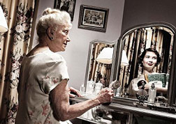 old woman sees young self in mirror