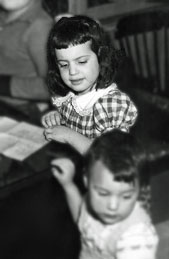 young Nikki scowling at sister